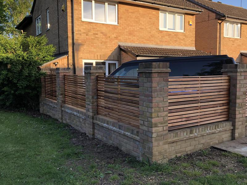 Image 8 - Garden wall and bespoke Cedar wood fence panelling.