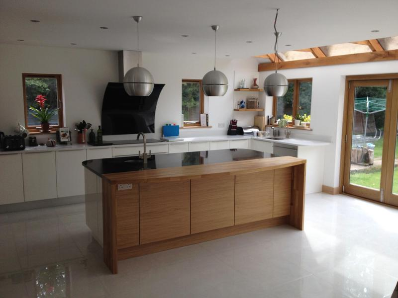 Image 1 - Bespoke top handle kitchen installed with custom made oak breakfast bar and plinth lighting.