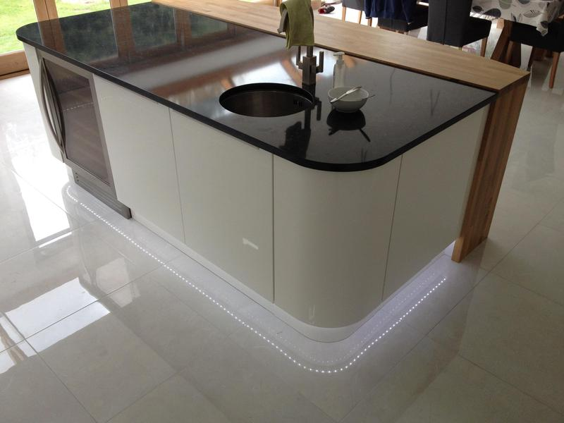 Image 8 - Bespoke top handle kitchen installed with custom made oak breakfast bar and plinth lighting.