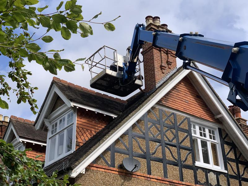 Image 20 - Chimney cowling installation to prevent bird's from nesting in the redundant chimney stack in Putney SW London using our in house 27 meter truck mounted cherry picker