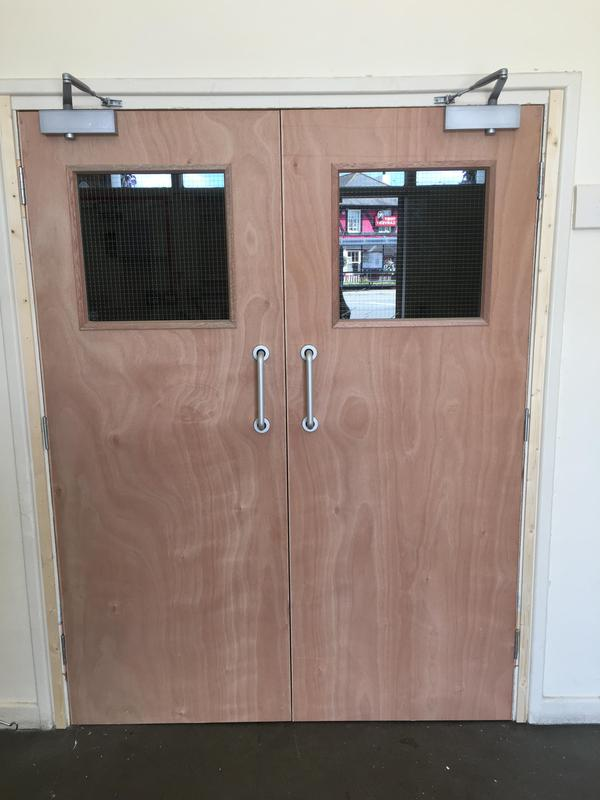 Image 17 - pair entrance fire doors