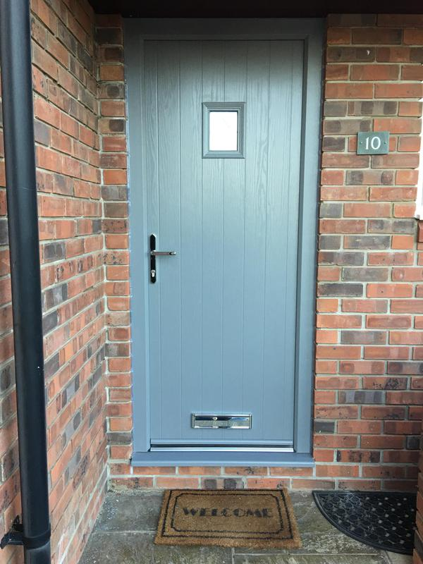 Image 39 - Anthracite Grey Cottage style composite door with grained frame to match