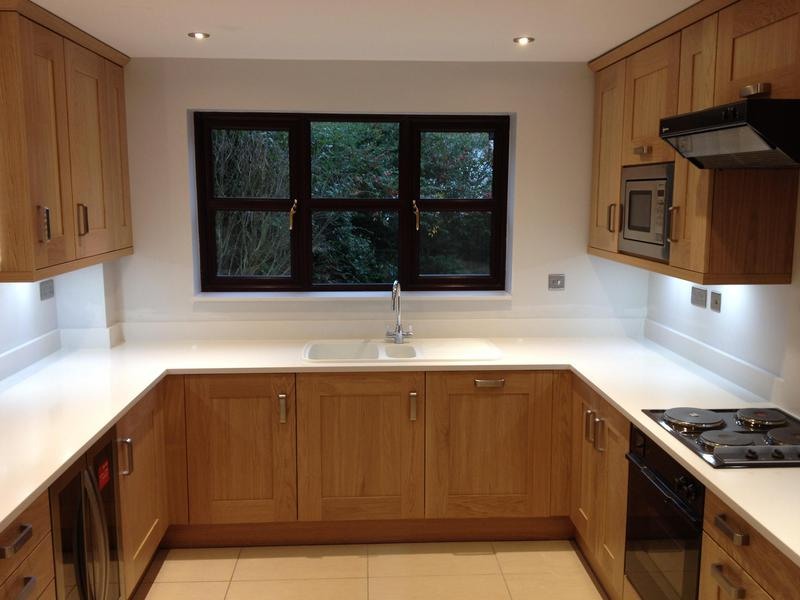 Image 49 - Oak kitchen installed with bespoke lit display unit.