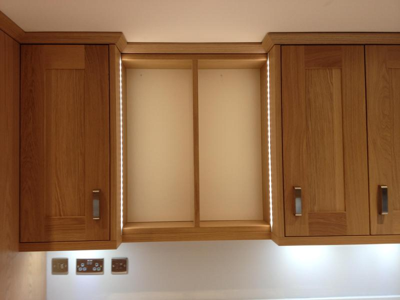 Image 51 - Oak kitchen installed with bespoke lit display unit.