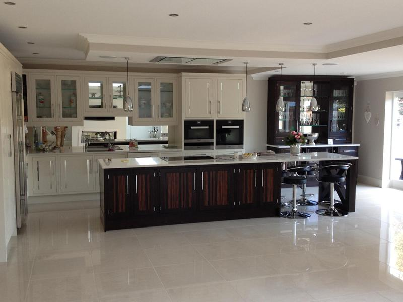 Image 52 - Bespoke Shaker kitchen with mirror inserts in doors and custom built breakfast bar end support.