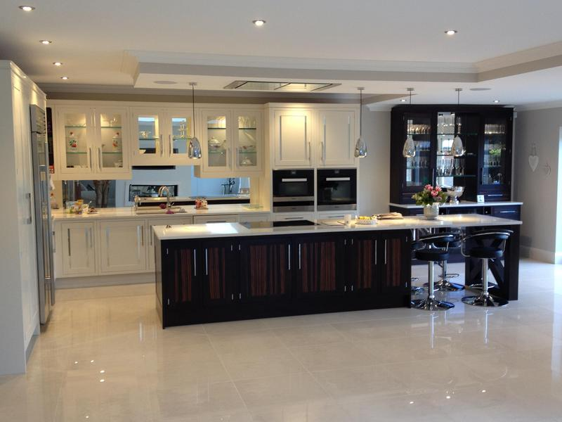 Image 53 - Bespoke Shaker kitchen with mirror inserts in doors and custom built breakfast bar end support.