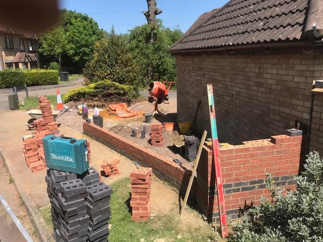 Image 24 - Pilar wall Guildford Surrey including installing stone coping stones