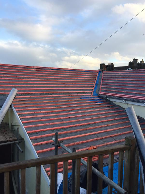 Image 35 - torquay Roof stripped and Felt and Battened.