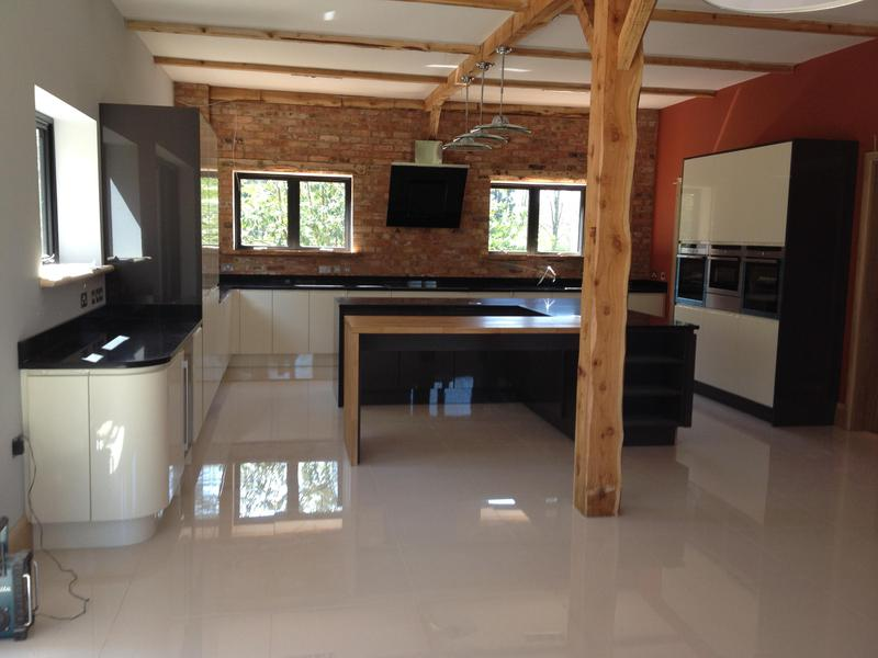 Image 28 - Bespoke gloss handleless kitchen and utility installed in massive barn conversion.