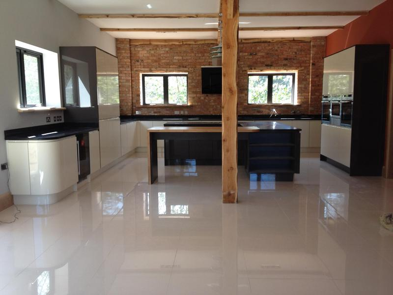 Image 29 - Bespoke gloss handleless kitchen and utility installed in massive barn conversion.