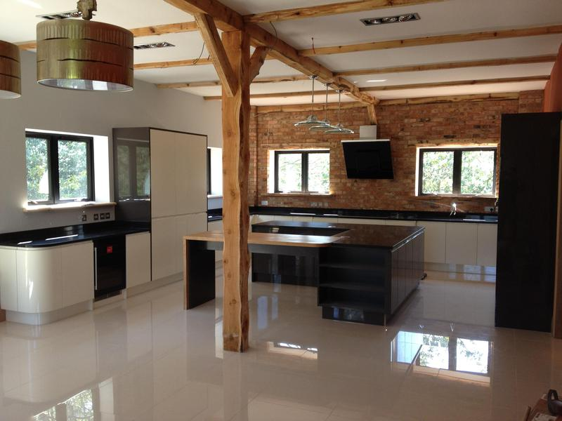Image 30 - Bespoke gloss handleless kitchen and utility installed in massive barn conversion.