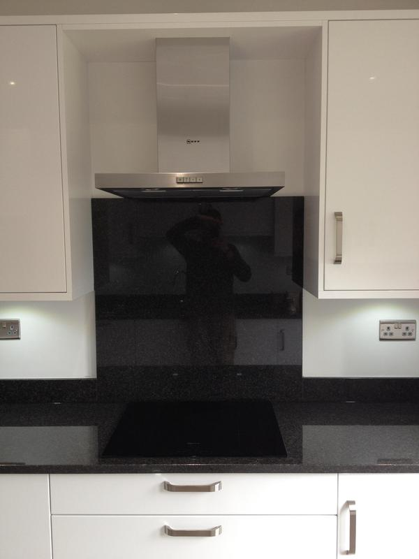 Image 25 - Gloss white slab kitchen installed as part of a full refurbishment with black quartz worktops and Karndean Flooring.