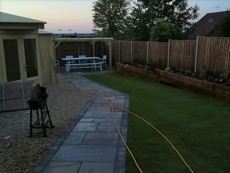 Image 6 - Log cabins, turf, sleeper flower beds, pergola, Marshalls indian sandstone paving and fencing