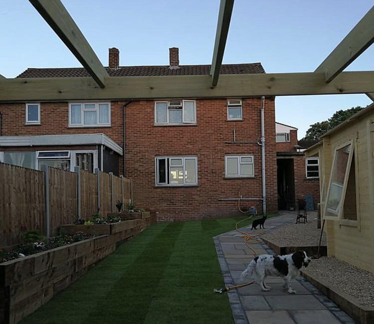 Image 7 - Log cabins, turf, sleeper flower beds, pergola, Marshalls indian sandstone paving and fencing