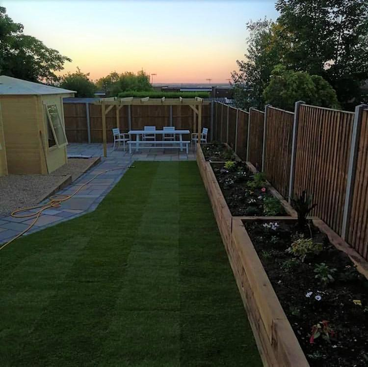 Image 9 - Log cabins, turf, sleeper flower beds, pergola, Marshalls indian sandstone paving and fencing