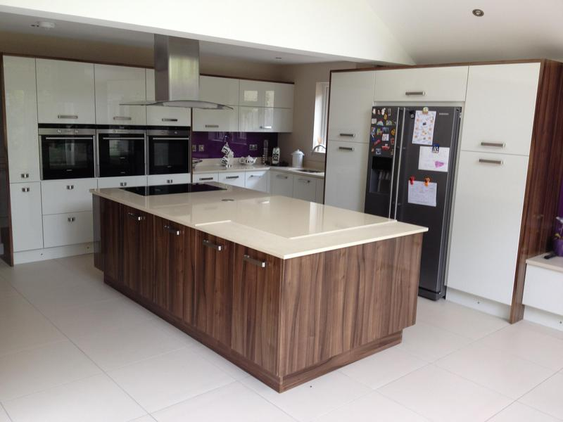 Image 87 - Two tone gloss kitchen installed with a plinth lighting and a bespoke crackle glaze glass breakfast bar.