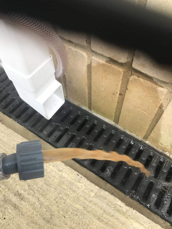 Image 5 - Power flush machine in operation removing sludge from heating system