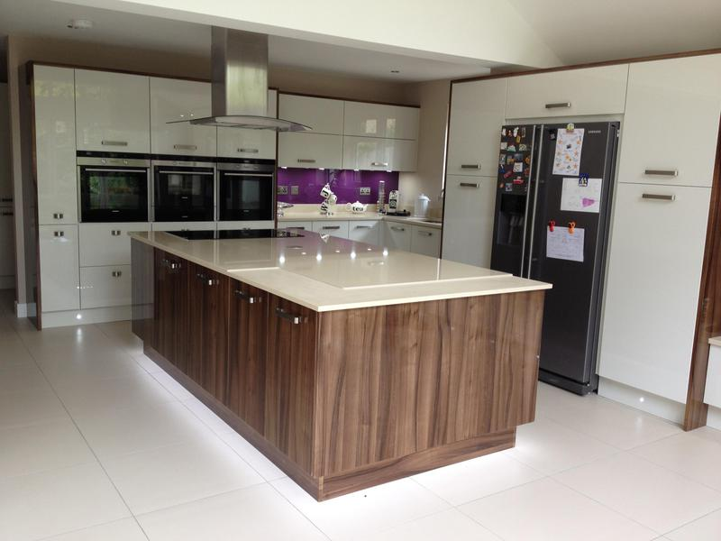 Image 89 - Two tone gloss kitchen installed with a plinth lighting and a bespoke crackle glaze glass breakfast bar.