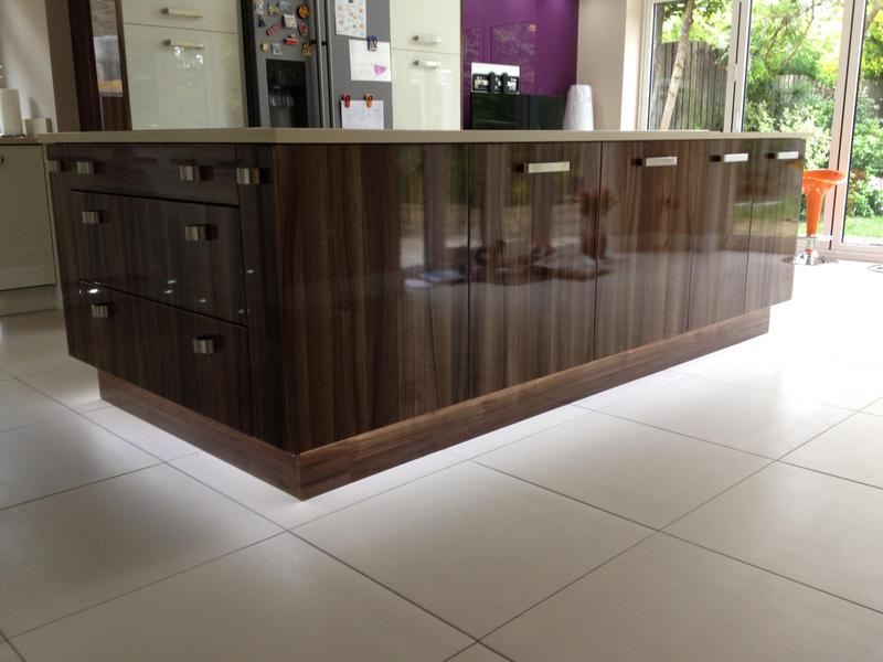 Image 92 - Two tone gloss kitchen installed with a plinth lighting and a bespoke crackle glaze glass breakfast bar.