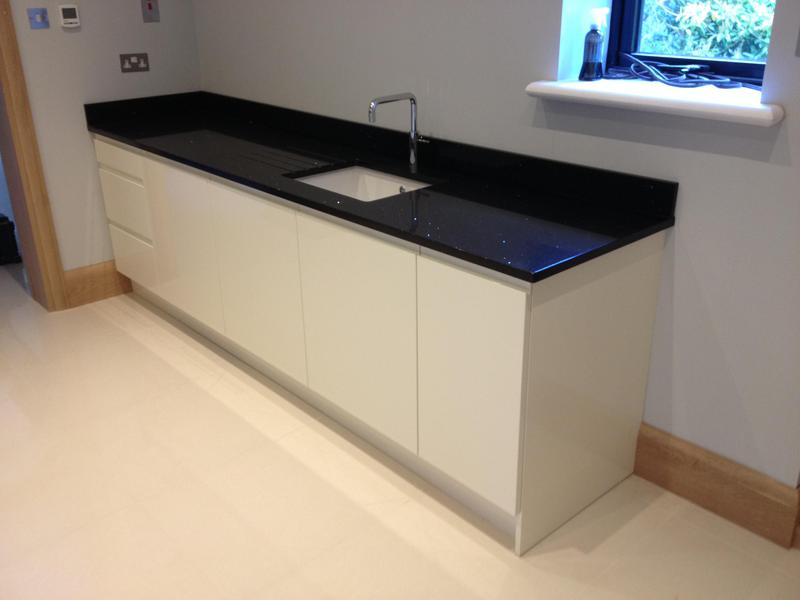 Image 33 - Bespoke gloss handleless kitchen and utility installed in massive barn conversion.