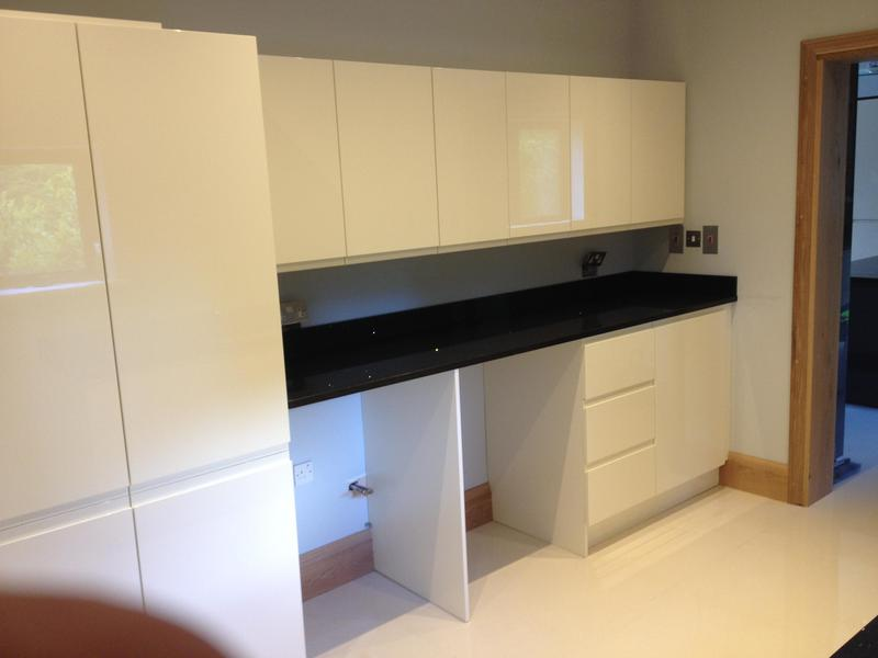 Image 34 - Bespoke gloss handleless kitchen and utility installed in massive barn conversion.