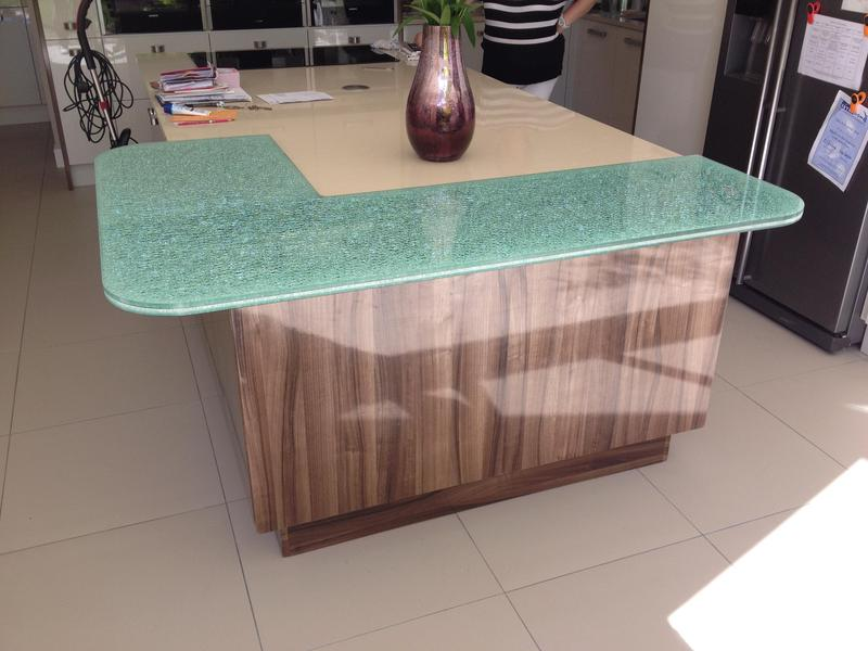 Image 93 - Two tone gloss kitchen installed with a plinth lighting and a bespoke crackle glaze glass breakfast bar.