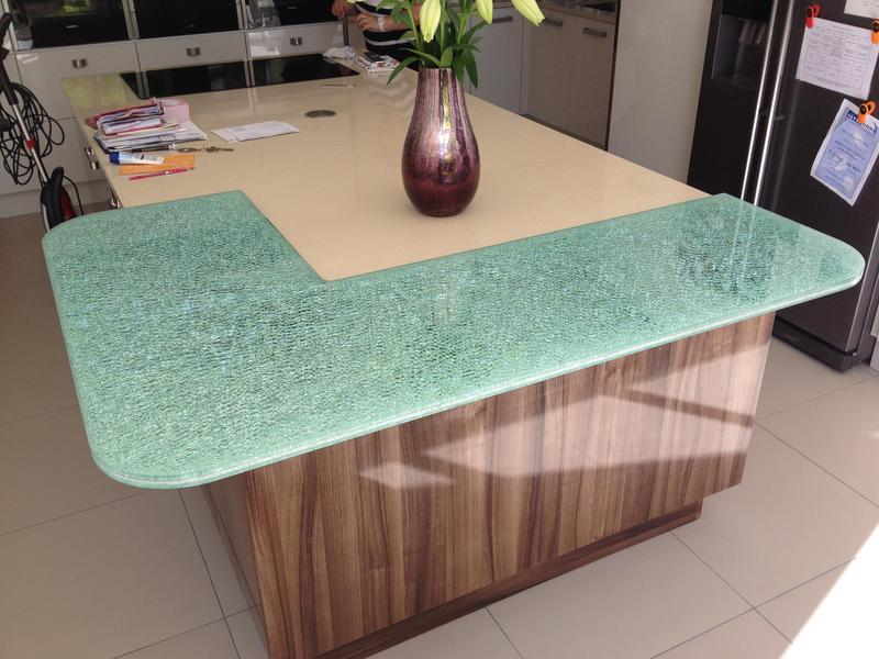 Image 94 - Two tone gloss kitchen installed with a plinth lighting and a bespoke crackle glaze glass breakfast bar.