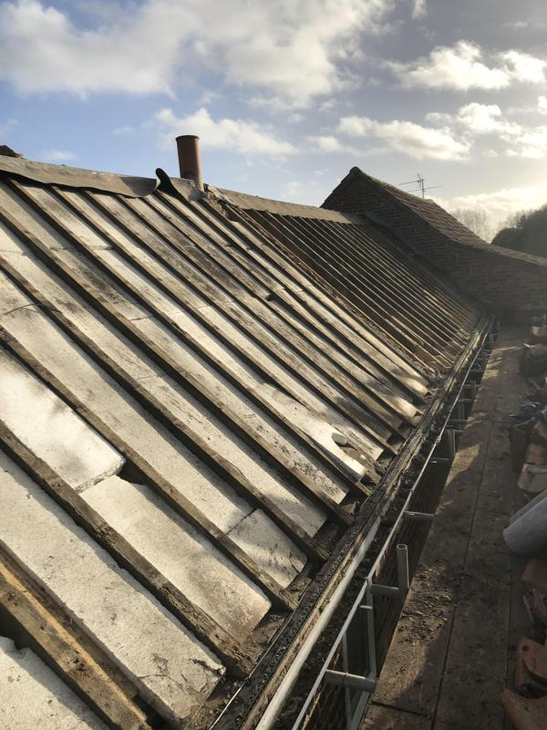 Image 1 - Strip down of roof ready for new felt and batten