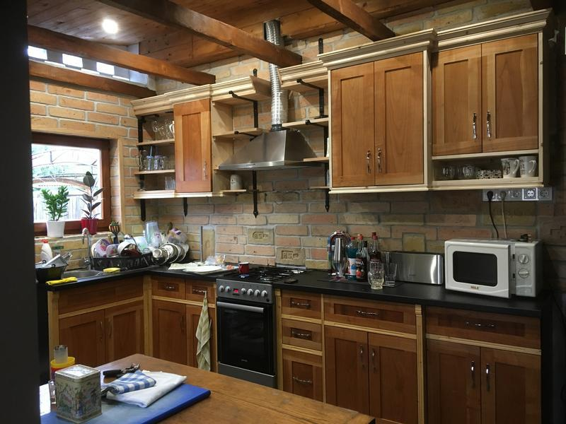 Image 12 - cottage style kitchen, with contemporary elements - old ceiling was removed to expose cross beams, kitchen has been designed to a shaker style, cherry doors and shelves, pine mouldings. Cover above extractor to be finished, and oil to be applied on high section mouldings.