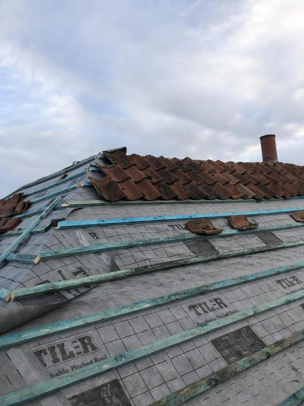 Image 13 - Start of putting roof back together for customer