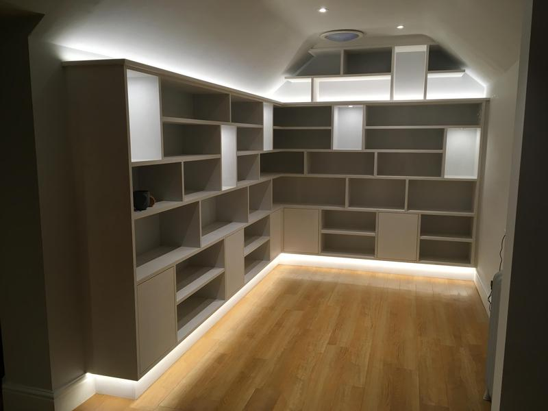 Image 16 - Bespoke library with random display areas , including led dimmable lighting . Producing a floating look.