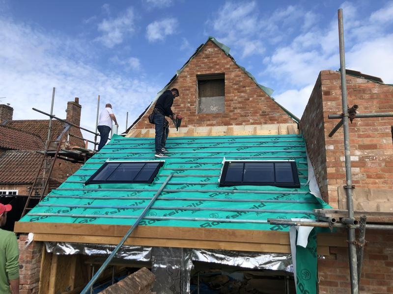 Image 7 - Velux windows fitted and re tiling using reclaimed materials