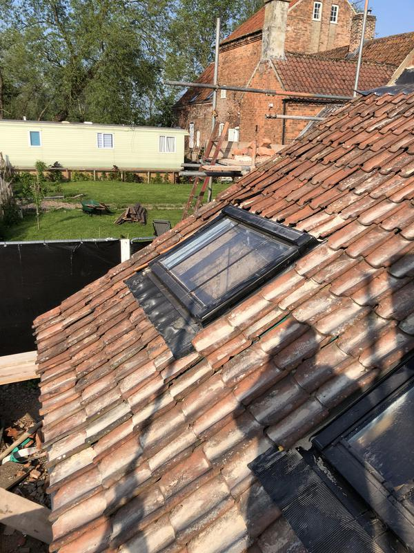 Image 4 - Velux windows fitted and tiled around.