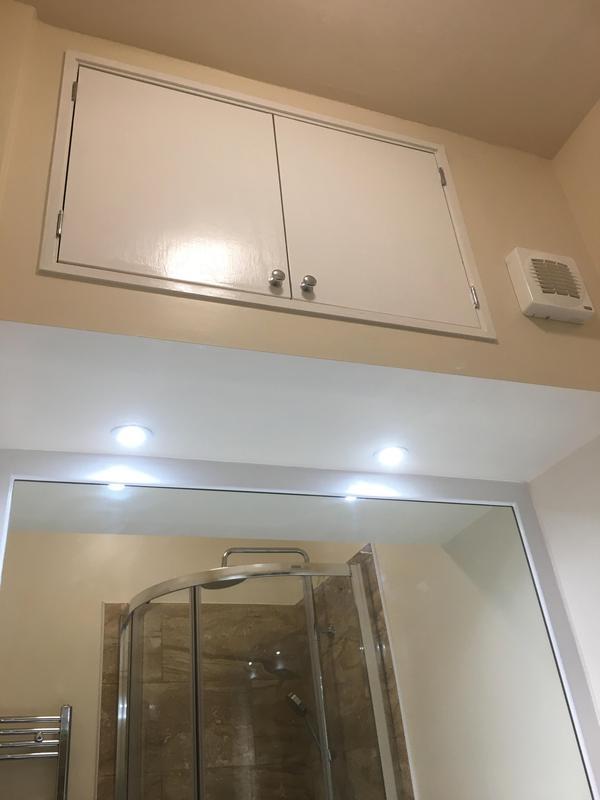 Image 13 - Overhead cupboards with handmade doors.