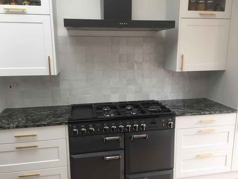 Image 13 - New tiled splash back over oven.