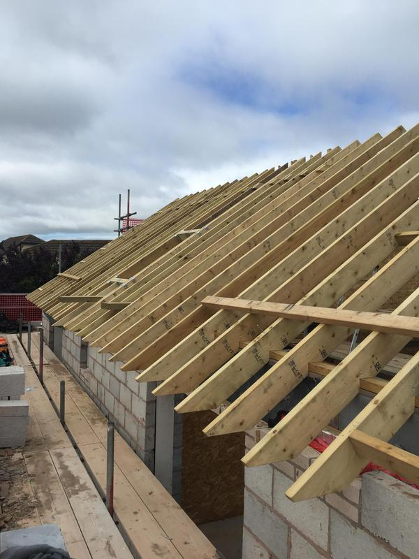 "Image 51 - New Cut Roof - Instow - new build. 9""x2"" treated timbers. On triple ridge beams bolted and glued for structural support. New solar velux windows to follow and PV panels."
