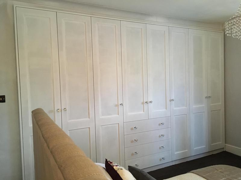 Image 13 - Wardrobes with integrated central dressing table area.