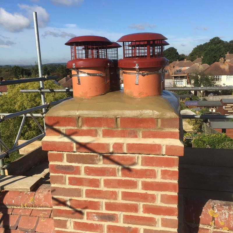 Image 38 - Chimney re-build and bird guard chimney cowlings fitted in Guildford Surrey