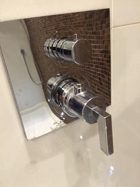 Image 33 - Hansgrohe shower with controls still set into position in Fulham.