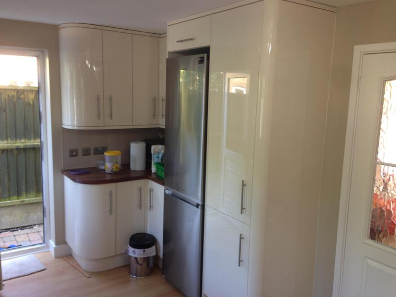Image 16 - Gloss slab door kitchen installed with curved units and end panels.