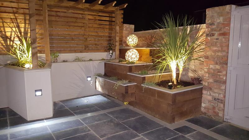 Image 17 - Black slate patio, planter walling, lighting