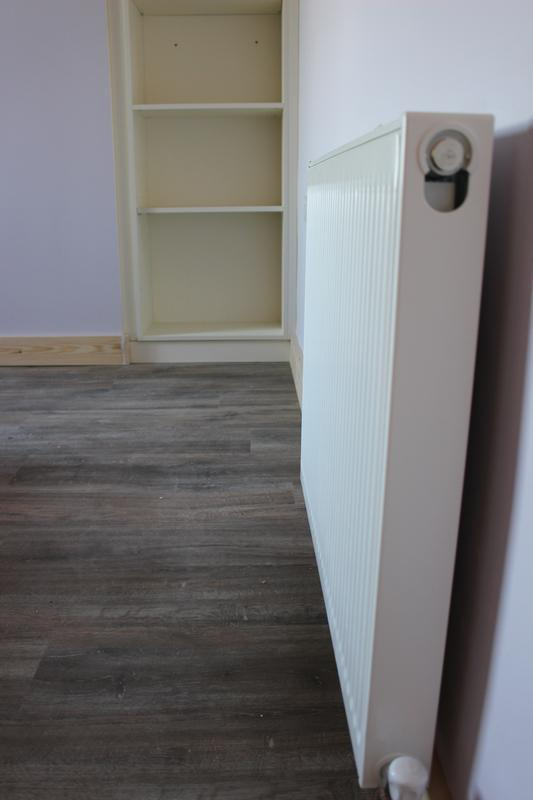 Image 13 - New radiator fitted and flooring