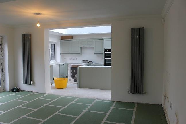 Image 23 - Knock through plastered and radiators finished