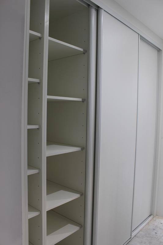 Image 39 - Hallway hidden storage space with sliding doors