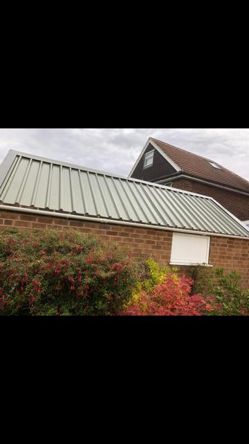 Image 6 - Example of an asbestos roof we moved and replaced with this lovely Grey sheeting to give it a new classy look