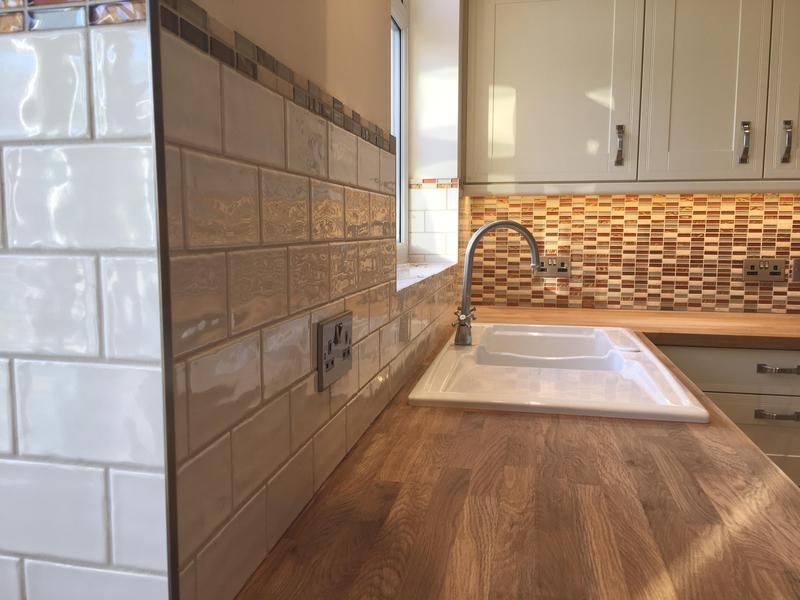 Image 14 - kitchen splash with a feature mosaic wall and metros with a mosaic border