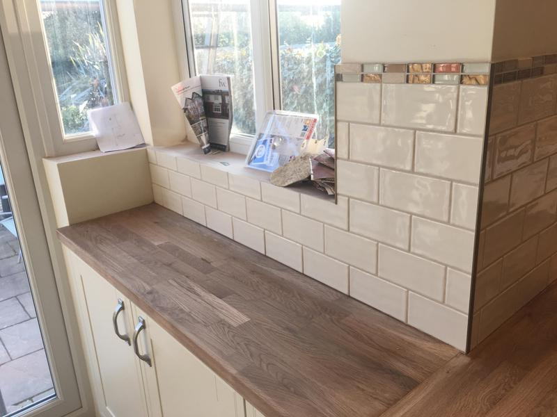 Image 15 - kitchen splash with a feature mosaic wall and metros with a mosaic border
