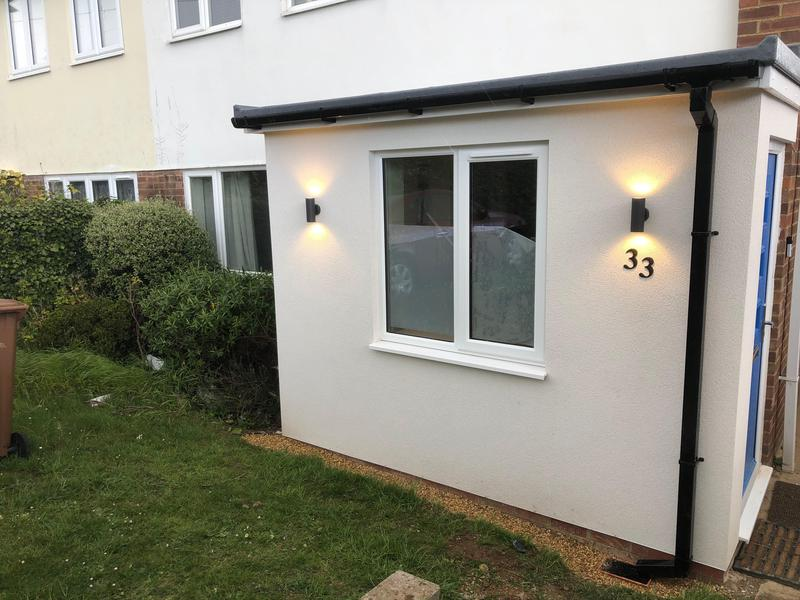 Image 3 - Monocouche finished porch with GRP roof and up/down feature lights. This was built to extend the entrance of the living space.