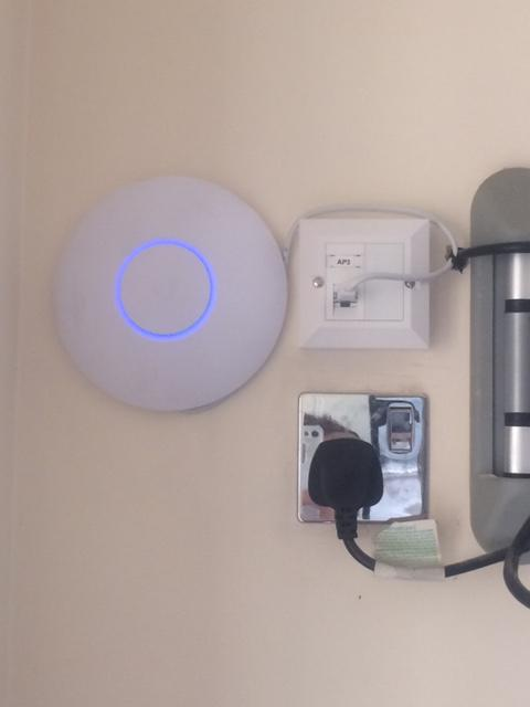 Image 4 - We supplied and installed this CAT6 socket and Wi-Fi access point behind the TV in a large house in Banstead. This improved the Wi-Fi signal in the kitchen.