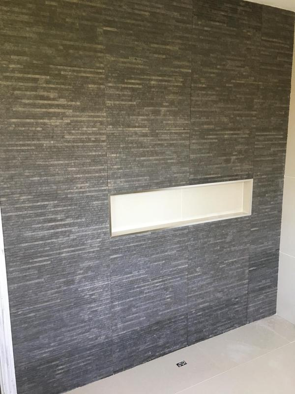 Image 22 - bathroom - walls and floor in 600 x 600 porcelain tiles with a feature wall with recess